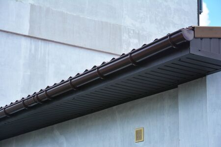 Close up on rain gutter system Stock Photo