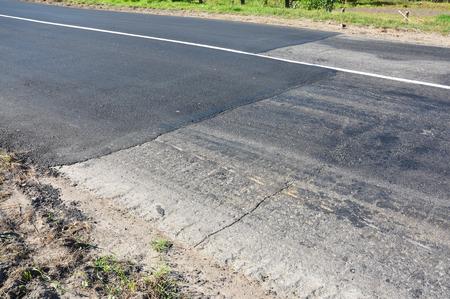 Close up on asphalt road repair. Laying new asphalt road.