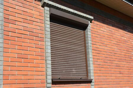 Window with rolling shutter for house protection.