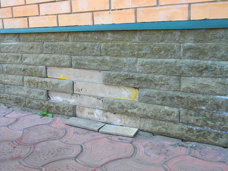 Foundation Repair - Warning Signs. House foundation repair.  Foundation Repair. Stock Photo - 86913517