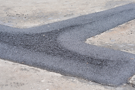 Repair pavement and laying new asphalt patching method outdoors. 版權商用圖片