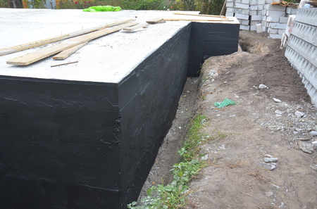 Waterproofing house foundation with spray on tar
