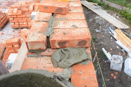 Bricklaying, Brickwork, Building Brick House Wall. Nobody. Stock Photo
