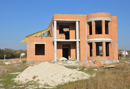 windows frame: Brick House construction site. Building construction brick house. Unfinished Home Construction.