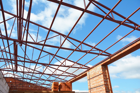 Roofing Construction. Metal Roof Frame House Construction. Stock Photo