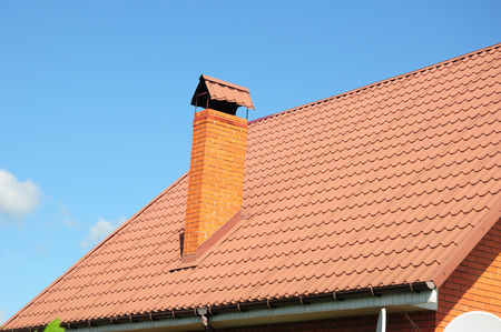 Red metal roof tiles. Metal Roof Shingles - Roofing Construction, Brick Chimney, Roofing Repair