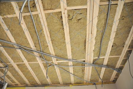Ceiling construction detail. Close up on ceiling construction details with electricity wire. Building construction gypsum plaster walls and ceiling. Ceiling Joists of Home Under Construction.