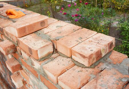Bricklaying, Brickwork. Bricklaying on House Construction Site. Building Home wall from Bricks