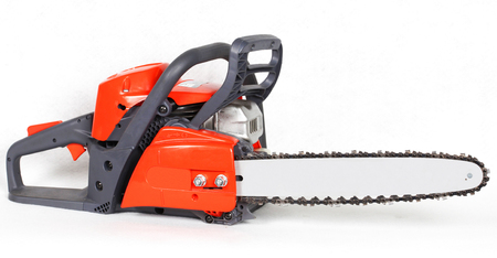Gasoline chainsaw isolated on white background. Close up on red Gasoline Chainsaw.