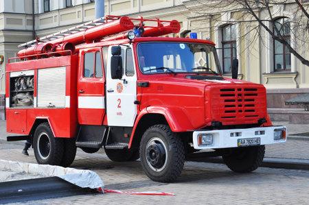 KIEV, UKRAINE - February, 22, 2017: Red firetruck Kraz ride on call fire suppression in the city street. Red firetruck.