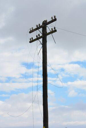 Wire breakage after hurricane. Broken power line. Фото со стока