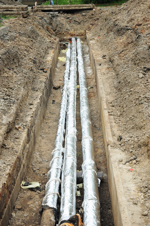 Pipe insulation. Breakthrough sewerage system.Pipes for water in an earthen trench. Repair and replacement of sewer with insulation for energy saving.