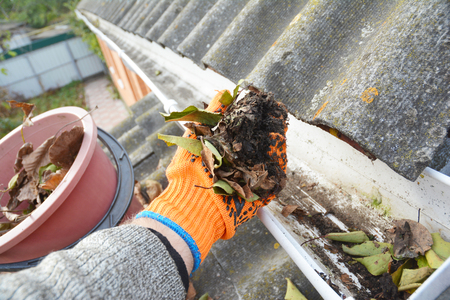 Roof Gutter Cleaning Tips. Clean Your Gutters. Gutter Cleaning. Archivio Fotografico