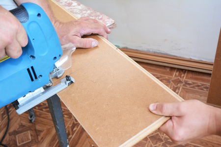 Contractor Cutting Laminate Flooring Lengthwise Workers Cutting