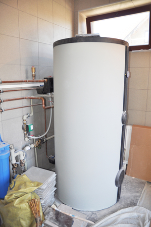 Hot Water Heating Boiler Installation. Condensing Boiler Accumulator Tank. 免版税图像