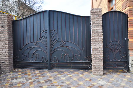 Installation of Stone and Metal Fence with Door and Gate for Car.  Archivio Fotografico