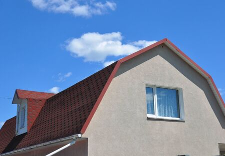 Close up on Attic Dormer Window and Roofing Construction.