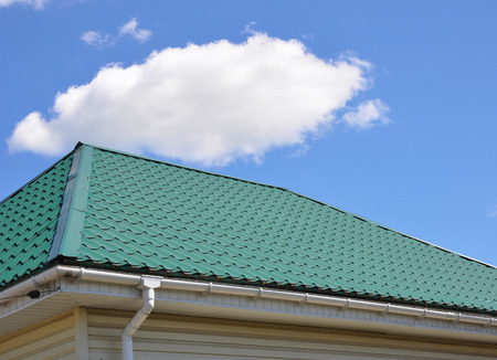 Green Metal Roof and Rain Gutter House Exterior