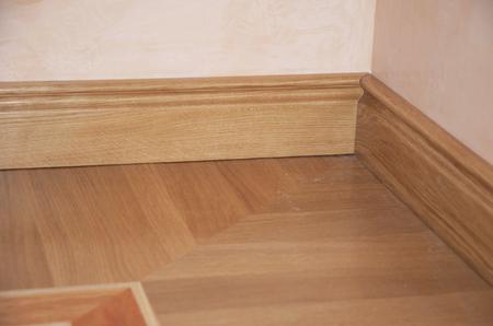 Skirting Board & Architrave. Wood Flooring. Skirting Board Oak Wooden Floor . Flooring with Wooden Batten Repair.