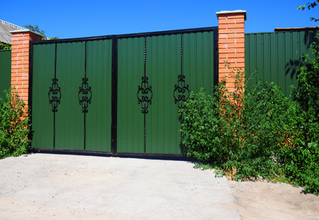 Metal Fence Door, Gate. Residential House Metal Fence Gate. Photo