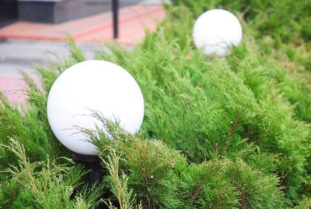 Outdoor lighting in green bush. Outdoor lights home. Stock Photo - 92760920