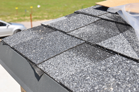 Asphalt Shingles Roof Installation.  Install Asphalt Roofing Shingles. Roof Shingles - Roofing Construction, House Roofing Repair. Stock Photo