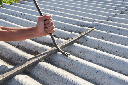 Asbestos Removal. Roofer Safe Handling and Removal of Asbestos. Roofing construction.