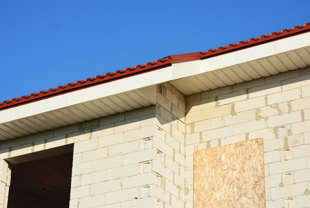 Plastic fascias board roof installation with soffit, eaves.