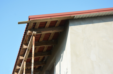 Repair and installing house  roof eaves, soffits and fascia boards. Stock Photo