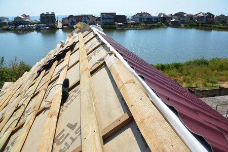 KYIV, UKRAINE - September, 05, 2017:  Metal roofing construction. Install metal roof. Editorial
