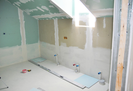 Remodeling attic bathroom with drywall repair, plasteringpainting, stucco. Bathroom repair and renovation with gypsum plaster boards Stock Photo