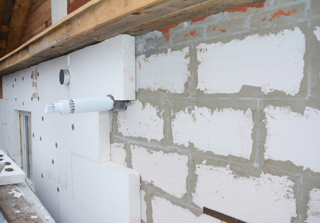 Installing rigid foam insulation around  gas convector chimney smoke pipe. Problem area.