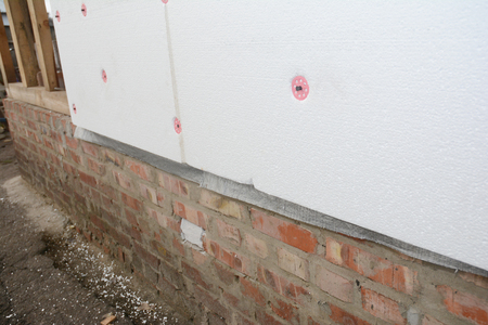 House wall renovation with external rigid styrofoam board insulation outdoor for energy saving.
