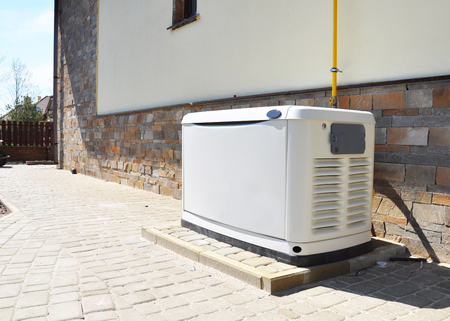 Residential house natural gas backup generator. Choosing a location for house standby generator. Imagens - 97722476