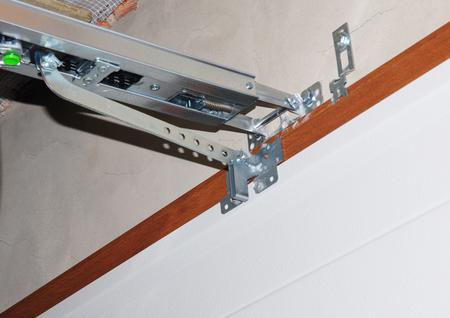 Garage door opener system. Installing garage door opener. Imagens