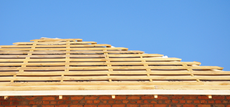 House roofing construction panorama. Installing Wooden rafters, logs, eaves, timber.