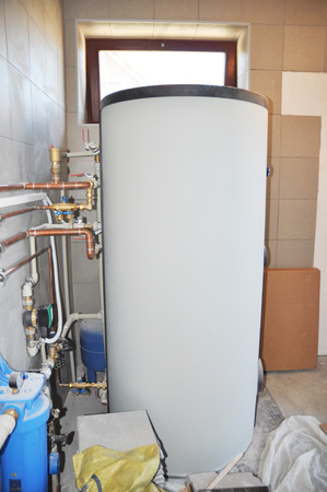 Installing solar water tank in boiler room. Solar water heating system.