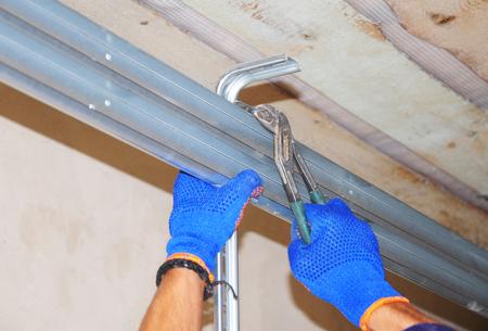 Ð¡onstruction contractor repair house garage door opener system.