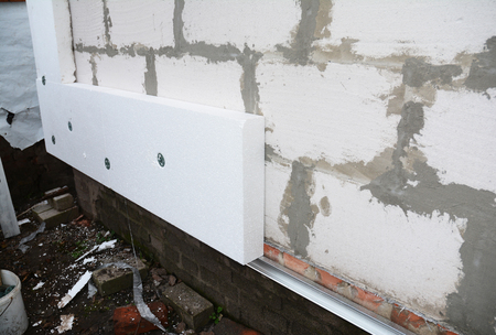 External wall insulation with polystyrene insulation sheets for house energy saving.