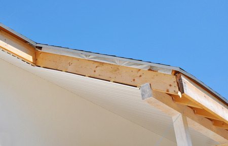 Close up on house roofing construction with installing soffits and fascia boards. 版權商用圖片