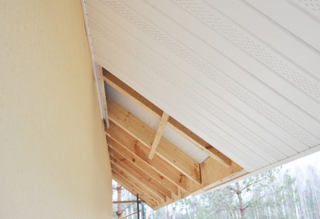 Installing soffit and fascia boards.