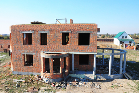 Building residential  brick house construction with column and concrete  frame for conservatory.