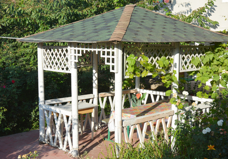 Beautiful alcove, wooden arbor, pavilion, bower, summer house, garden house.