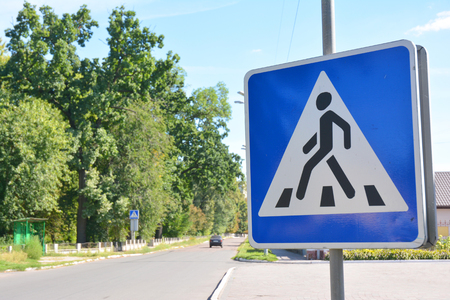 Pedestrian crossing sign on the street