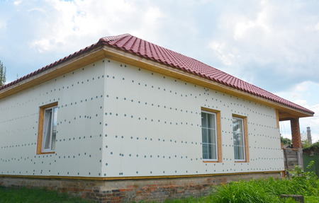 Unfinished house insulation ready for  plastering wall with rigid foam insulation. House foam insulation for energy saving. Stock Photo