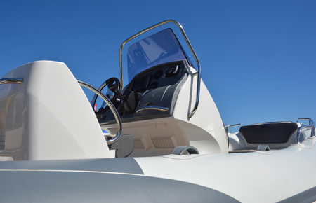 Close up on motorboat, speedboat details.  A motorboat, speedboat, or powerboat is a boat which is powered by an engine.