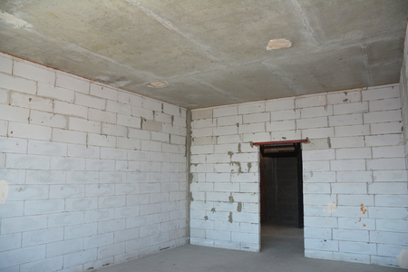 Interior room under construction. Wall without plasterwork. Stock Photo
