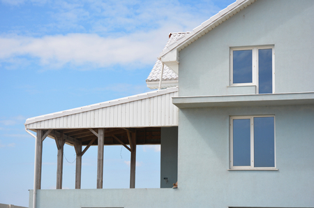 Unfinished balcony and house veranda patio with white clay roof. Stock Photo