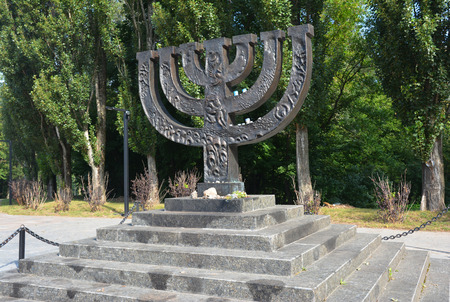 KIEV - UKRAINE SEPTEMBER - 03,  2018: A menorah memorial dedicated to jewish people executed in 1941 in Babi Yar in Kiev by German forces. Holocaust.