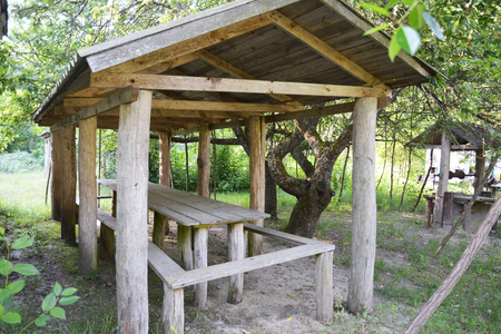 Beautiful alcove, wooden arbor, pavilion, bower, summer house, garden house in the rural garden. 스톡 콘텐츠